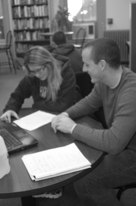 Keri GLeason and Dan Dierking review notes during a tutoring session at the Student Success Center. Photo by Brittany Krenzelak.