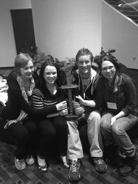 SAU's Tech Team from the stage crew showdown with their golden wrench award. Pictured left to right: Amanda Zweibohmer ('16), Kristen Jett ('13), Daniel Conlin ('13) and Sidney Junk ('14). Photo submitted.