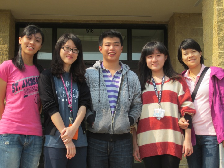 Chinese students stand outside of their new home for the semester, West Hall.