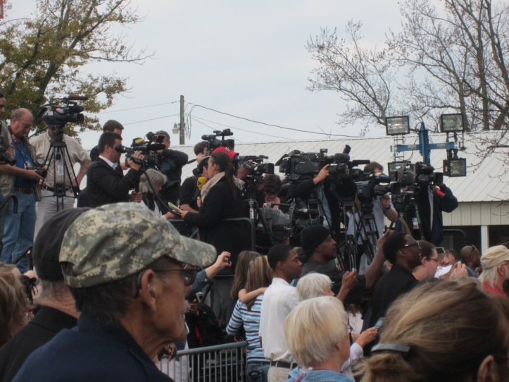 Press teams from the QC and national news stations.