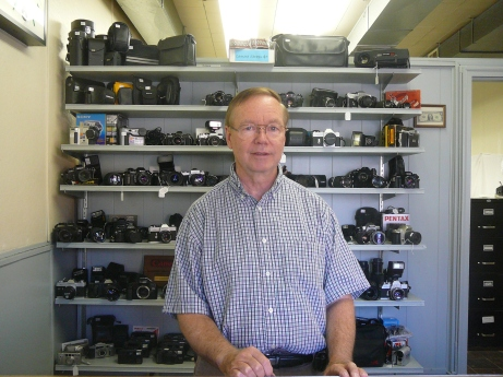 Tom DeWinter, of United Camera Repair in Rock Island is a co-owner of the business that's been open since 1955. Photo by Kelly Steiner