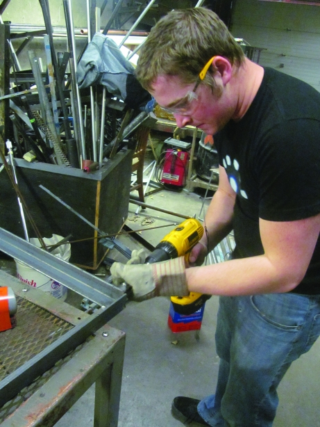 """Patrick Dunnegan cleans and prepares a metal frame for the set of """"Chicago."""" Patrick Kwiatkowski/The Buzz."""