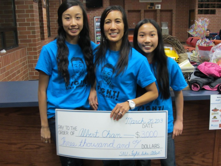 Cora Chan and daughters were presented with a $3,000 check on March 20. Kyle Porter/The Buzz.