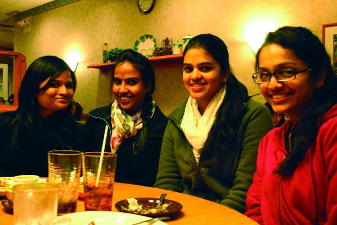 Hyndava Peddi, Srayva Bathina, Preethi Chirla and Akshita Gupta enjoy Free Pie Wednesday at Village Inn. Photo by Mary Schechinger.