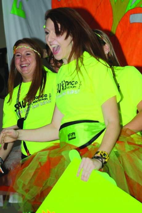 Morale captains Colleen Krahn (left) and Ally Hunter are all smiles while on stage performing the morale dance. Brittany Krenzelak/The Buzz.