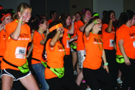 The morale team created a dance with a variation in music styles and genres of music. This dance was taught to all the dancers and was completed on the hour, every hour. Brittany Krenzelak/The Buzz.