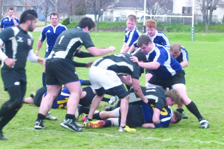 The St. Ambrose rugby team members defeated Wartburg 31-14 on Sat., April 13 on Timmerman Field. The Buzz/Submitted.