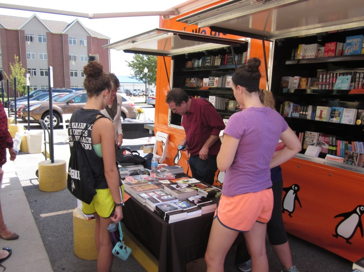 Students were able to buy books from the book mobile, which was parked near the St. Ambrose Library on Sept. 27. Rachel Pasker/The Buzz.