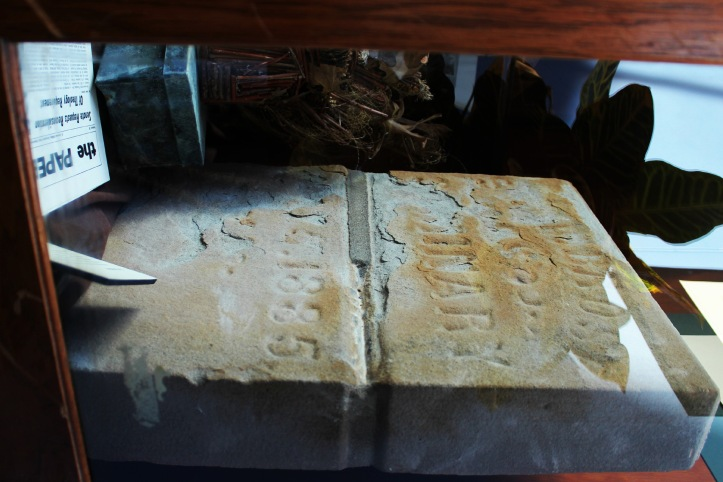 The 1885 cornerstone and time capsule are on display on the third floor of the library. Emma Williams/The Buzz.