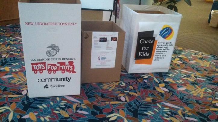 Donation boxes for Toys for Tots and GiGi's Playhouse set up throughout campus welcome a variety of donationis for the less fortunate. Rachel Pasker/The Buzz.