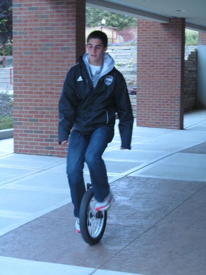 A.J. Adam demonstrates his unique form of transportation that has many students turning their heads. Pat Kwiatkowski/The Buzz.