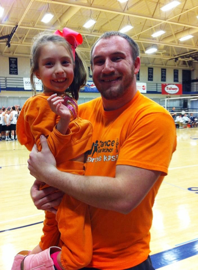 Linderman holds Madi Ramirez, one of the kids Dance Marathon supports. Submitted/The Buzz.