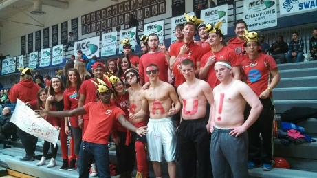 The Swarm shows their SAU spirit by cheering at a basketball game. Submitted/The Buzz.