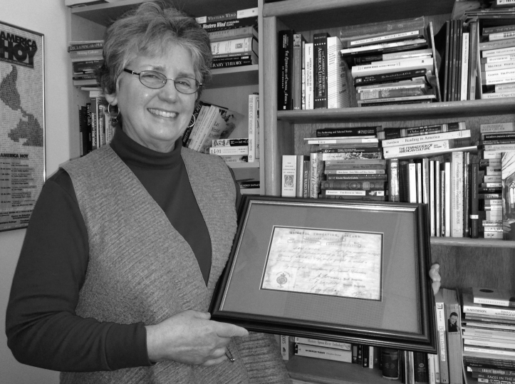 Dr. Beatrice Jacobson is holding her great-grandmother's graduating certificate from 1974, which not only represents one of her family's accomplishments, but also the root of her passion. Marilou Terrones/The Buzz.