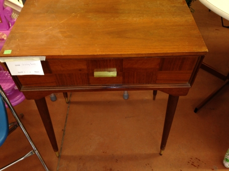 A vintage sewing table that can be used for a desk or night stand for $7.99. Emilee Renwick/The Buzz.